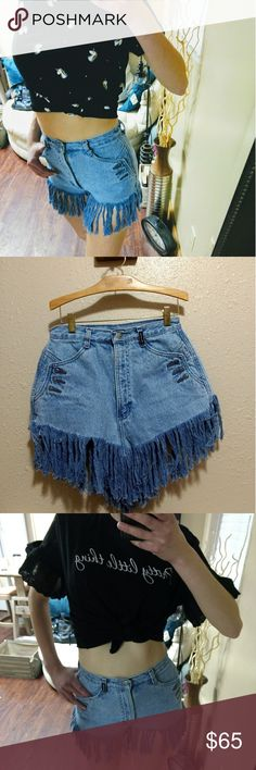"The Ultimate Festival Shorts Super sweet fringe jean shorts... Bought and were too small for me, my loss your gain.  Would fit a 27/28 best. I don't have two different sizes. Unicorn crop top and pretty little thing crop top also listed for sale in my closet!  Measurements: Waist 12"" Rise 12.5"" Vintage Shorts"