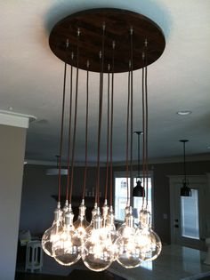 Custom Industrial Chandelier with Modern Glass by PolitelyBlunt
