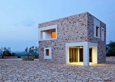 """Holiday """"village"""" for an ex-footballer comprises seven cuboids with stone walls."""
