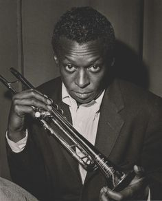 Miles Davis may not have been a guitar cat, but he did so much for jazz and young guitarists like Mike Stern and John Schofield.