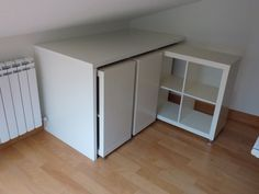 Materials: Expedit, Linnmon Description: I live in a duplex in which the upper floor has an inclined ceiling. In a corner I have my computer desk, and behind my back the ceiling is pretty low, and I need to make the most of it. So I thought of something like this, using three 2×2 EXPEDIT [&hellip
