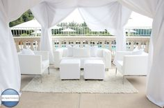 White tents and couches at weddings