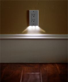 Night light that is built into the face of the outlet plate... doesn't cover any outlets, low energy, and looks great.