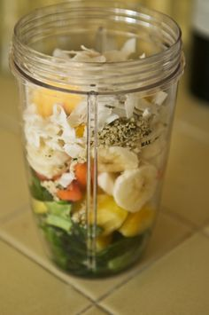 Collards, Pineapple, Carrots, Banana, Frozen Peaches, Coconut Flakes, Hempseeds, Add Water & a Splash of Coconut Milk & Blend.