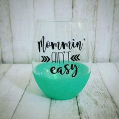 Mommin Aint Easy // Sparkle Wine Glass // Glitter // Birthday Gift // Wine Lover // Mom Gift // Glitter Dipped // Stemless by NorthwoodsMamaCo on Etsy #GlitterSparkle