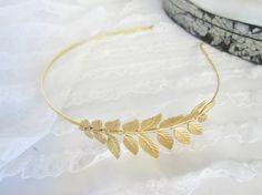 SALE Gold Grecian  leaf Headband for your by PeacockandLotus, $25.00    https://www.etsy.com/listing/118911063/sale-gold-grecian-leaf-headband-for-your