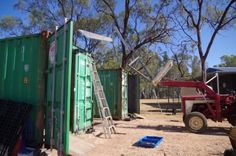 lifting steel rafter frame on shed