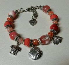 Check out this item in my Etsy shop https://www.etsy.com/listing/230194481/coral-beachfront-charm-bangle-bracelet