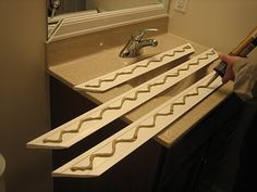Framing bathroom mirrors - a great tutorial with step-by-step instructions  pictures.