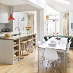Consider how much natural daylight will flood into your kitchen when planning. Skylights in the ceiling of an extended space will make a room feel really airy and bright, while white walls and fittings will help to bounce light around. However, not everything needs to be white and there's plenty of scope to add the odd colourful accessory.