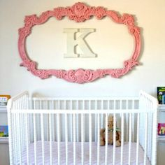 Frame a monogram. Would work for more than just a nursery.