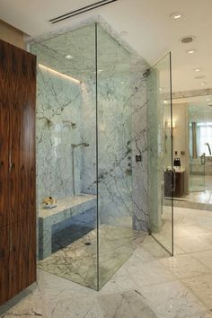 Jamie Herzlinger: Stunning master bathroom with floor to ceiling frameless glass shower with marble shower ...his and hers shower heads