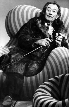 Salvador Dali in a striped UP 5_6 Armchair, designed by Gaetano Pesce for C&B Italia in 1969 and relaunched in 2000 by B&B Italia.