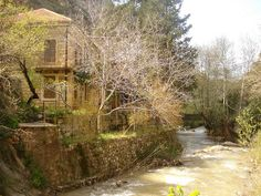LEBANON,  A PRETTY HOUSE ON THE RIVER SIDE