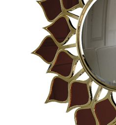 "Goa Mirror - Resembling an hypnotic flower, our Goa #mirror is a #sensory experience just like the #spices, #flavors and #fragrances that the first #Portuguese #sailors encountered in what is now #India. Goa is more than a mirror – with its #bronze-colored mirror ""leaves"" and #gold leaf finish, it is a #mesmerizing #decorative piece capable of invoking the #essence of fascinating foreign lands."