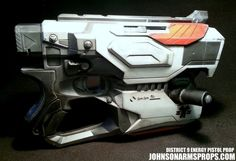District 9 Themed Nerf Diatron by JohnsonArmsProps on DeviantArt Nerf Mod, Futuristic Armour, Character Sheet, Main Character, Sci Fi Weapons, Custom Guns, Custom Paint, Larp, Firearms