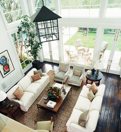 the dark rustic floor with the high ceilings and windows is just lovely :)