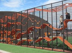 "vertical mesh screens enclose a series of undulating ribbons. ""Walhalla"" from Dutch design firm CARVE.Two vertical mesh screens enclose a series of undulating ribbons. ""Walhalla"" from Dutch design firm CARVE. Playground Design, Backyard Playground, Children Playground, Playground Ideas, Modern Playground, Plastic Playground, Inside Playground, Cool Playgrounds, Natural Playgrounds"