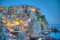 Manarola, Italy at dusk.  The Cinque Terre (five lands) has to be one of the most famous landmarks of the Italian Riviera. The five lands which are RioMaggiore, Manarola, Corniglia, Vernazza and Monterosso joined UNESCO's list of World Heritage Sites back in 1998 and really is one of Italy's best preserved areas, in terms of both the history of its people and its natural scenery.
