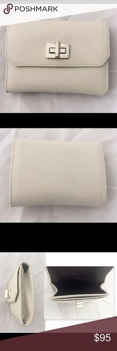 Selling this Prada saffiano white wallet in my Poshmark closet! My username is: angelspace. #shopmycloset #poshmark #fashion #shopping #style #forsale #Prada #Handbags