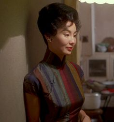 Two Brown Girls - Maggie Cheung wears a different cheongsam (qipao)...