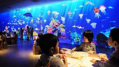 """""""Here's how it works: First, children choose a template of the fish that they want to see swim in the aquarium and color it however they like. After scanning the completed drawing, their fish appear on a giant screen and start swimming around. The images are programmed to move like real fish, undulating and changing direction in the water. Adding a playful, interactive element to the display, a piece of food will appear when children get close to the digital screen, causing the fish to…"""