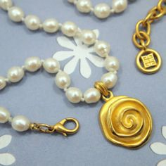 """Reserve Now - And Receive Free Shipping  Vintage Givenchy Swirl (Rose) Pendant Gold Plated 16-19"""" Chain of Real Glass Freshwater Pearls. We have the matching 8"""" bracelet and a pair of matching studs in the store for sale already. The necklace is the perfect match for the bracelet and pierced earrings. Free Shipping to the US and www.CCCsVintageJewelry.com. Have a great weekend. The three pieces will make a lovely set. Best, C."""