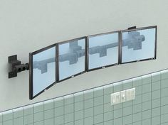 Outside of Prison Suites, wall mounted surveillance monitors will provide extra surveillance with regular check ups | Wall Mount Multi Monitor Arm Mount | afcindustries