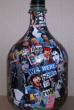 This handmade bottle collage is a tribute to the Boss and his career. Clippings and images here from the old days trace his contribution to Rock and Roll. The bottle has the song title- Glory Days, and a lyric from Born to Run- Tramps like us, baby we were born to run. Album covers, magazine covers, band members, tour posters, and new and old clippings of the hardest working man in rock. The finished bottle is coated with ultra clear polyurethane so it can be handled as it is appreciated…