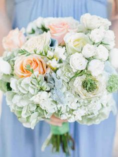 Mix in all different sizes and colors of complementing flowers to your hydrangea wedding bouquet by using classic roses and spray roses.