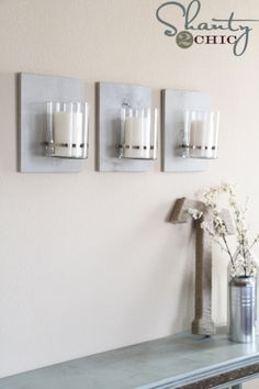 Wall scones using hose clamps and inexpensive vases