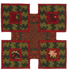 The colors in these Log Cabin blocks are similar in value, but each round is  clearly visible because the colors are opposites on the color wheel. The  festive four-block table topper features the Holiday Splendor collection by  Yolanda Fundora for Blank Quilting.