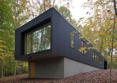 In Situ Studio hides a black cabin in a North Carolina forest