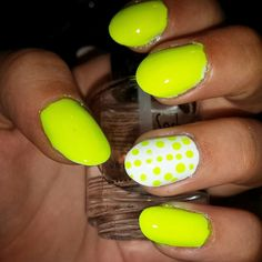 Neon yellow nails with dots