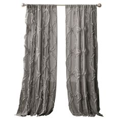 Bring a timeless touch to your master suite or living room with this lovely curtain, showcasing a ruffled trellis design for stylish appeal.