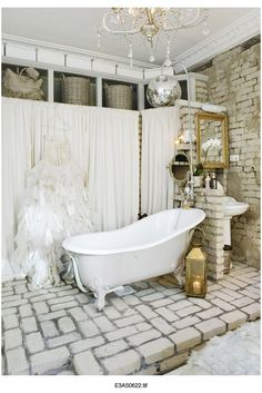 Glam vintage bathroom - this is ridiculous but come on, who doesn't want a disco ball over their tub?!