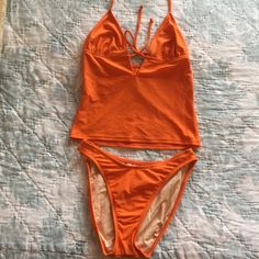 Tangerine Tankini! This tangerine color is BIG this spring and summer! No tags, but never worn. Victoria's Secret Swim Bikinis