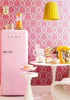 smeg retro fridge in pink, yellow, orange and white kitchen