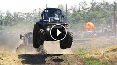 Awesome Event From Russia - Off Road Flying Tractors Racing - Crazy tractor racing competition at Bison Track Show 2014 in Rostov, Russia...Fearless machine operator