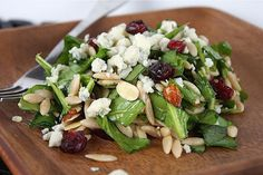 Spinach and Orzo Salad with Cranberries and Almonds - Aggie's Kitchen (Dinner Lunch Vegetarian Wheat Dairy Vegetables Fruit Gluten Egg products Animal products Salads Poppy seeds Salt Paprika Sesame seeds Canola oil Gorgonzola cheese Black pepper Cider vinegar Almonds Dried cranberries Orzo Baby spinach Onions Sugar)