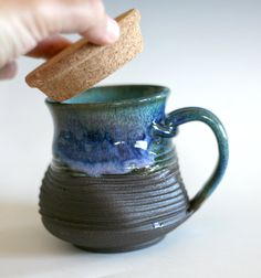 "4 tall, 2.75"" opening, holds 12 oz    The dark clay used for this mug is fired to a deep, rich brown. Part of the exterior is left unglazed with light"