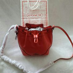 COACH BAG Pretty Coach Baby Mickie Drawstring  Shoulder Bag in grain leather. Inside zip and multifunction pockets.  Drawstring closure, fabric lining.  Strap with 23 drop for shoulder or crossbody wear. New with tags.  F35363 Coach Bags