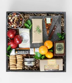 Three artisanal farmhouse cheeses are served with a cheese knife on a sleek slate board: 'Farmhouse Cheese Crate' by Winston Flowers.