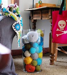 Nice way to store yarn and bring a lil color to a room.
