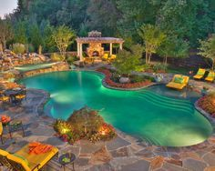 A beautiful pool to relax in or swim laps for exercise.  Lights and plants enhance the tropical feel of this backyard.