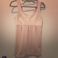 Lululemon Tank Top Gently worn. Blush pink. Perfect for barre or yoga class!  Adjustable cinch waist. Wide straps. Loose waist. Super comfortable, breathable top. lululemon athletica Tops Tank Tops