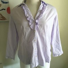 Talbots blouse Beautiful lavender color! It has some ruffles at the neckline. There's also ruffles at the wrists. It has some stretch to it. It buttons down the front. 95% cotton and 5% lastol. It's marked as 16. It fits 14/16. Talbots Tops Button Down Shirts