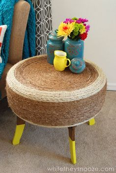 Wrap a spare tire (like the one you have in your trunk, not the one around your uncle's belly) in beachy sisal rope to hide its true automotive identity. Click through for more unique coffee table ideas.