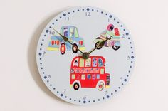 Transport Clock Cute round clock in a transport theme set on a blue background. Clock face features a big reg bus, car and a motorcycle, with gold hour and minute hands. | Childrens Bed Centres