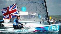 Ben Ainslie of Great Britain celebrates winning gold in the Finn class medal race at Weymouth and Portland on day 9.